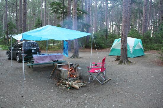 Tent camping to save money on a family vacation.