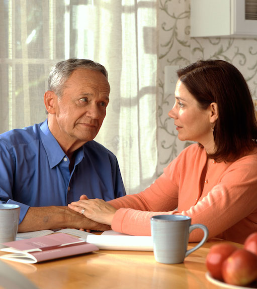 An adult daughter talking with her retired father about funeral plans.