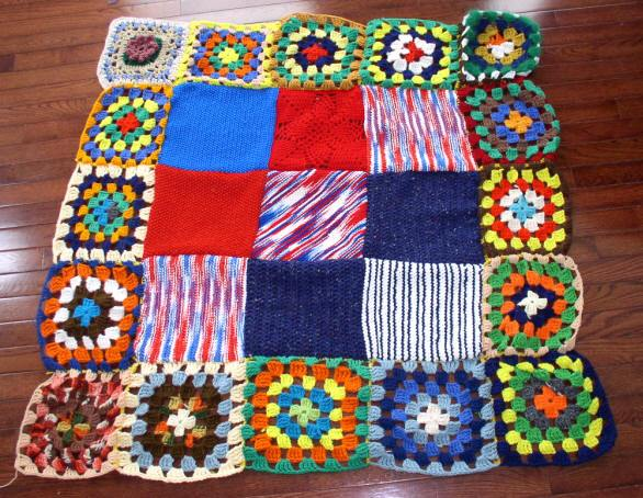 A colorful crocheted quilt.